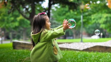 The Benefits of Using Lámh - Child Chasing Bubbles